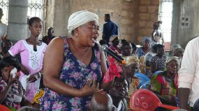 Local Business Woman expresses her concerns during a Townhall meeting in Ejura.jpg